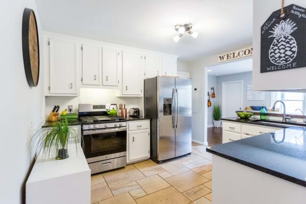 Painting the cabinets white helped to make this small kitchen feel more spacious.