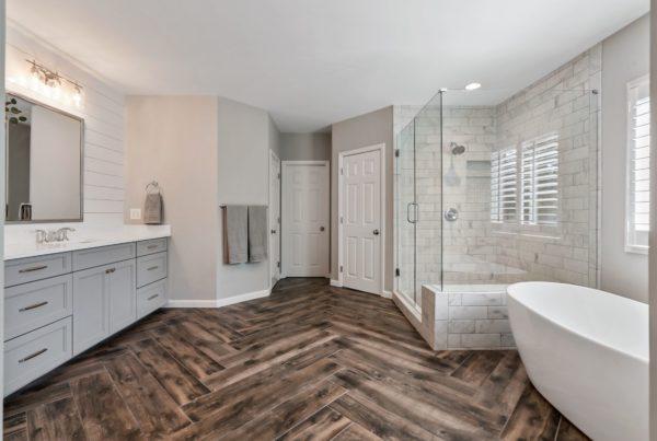 Beautiful master bathroom remodel, with wood look tile, layed in a herringbone pattern.