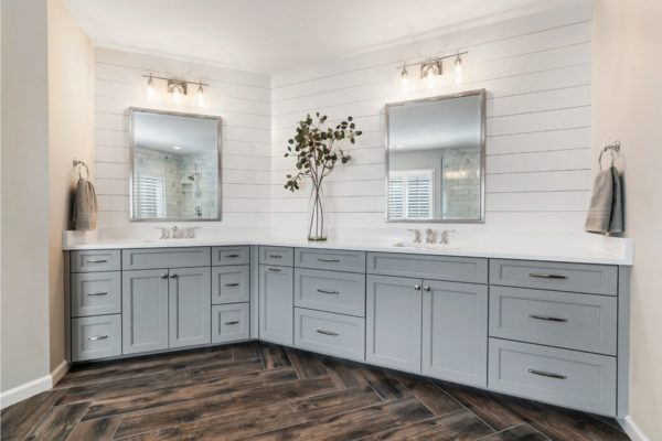 His and hers custom vanity, with shiplap walls, and metal framed mirrors.