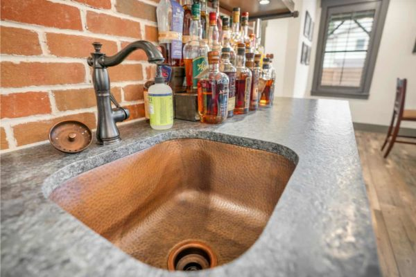Gorgeous leathered granite countertop, and hammered cooper bar sink.