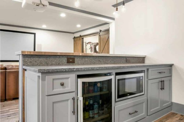 Back bar cabinetry, with space for undercounter beverage cooler, and microwave.