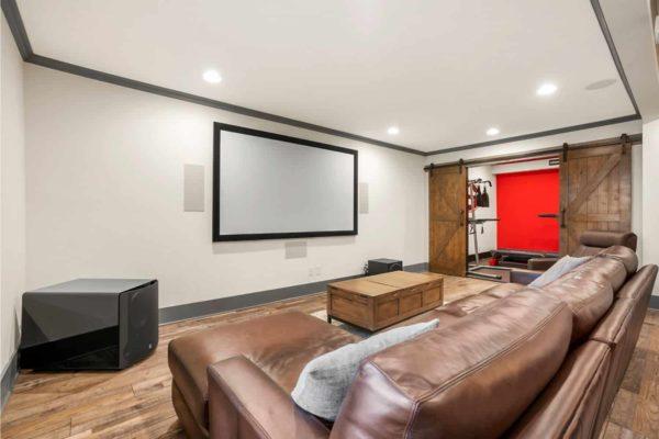 Basement media room, with LVP flooring.