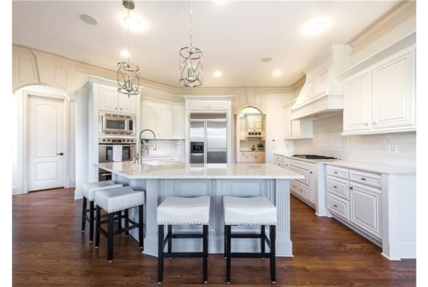 Beautiful kitchen renovation with newly painted white cabinets