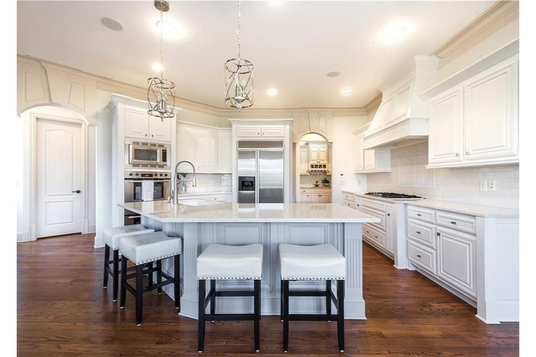 Beautiful kitchen renovation with newly painted white cabinets