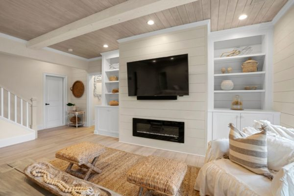 built in electic fireplace with shiplap surround