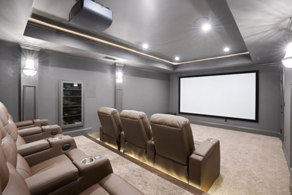 theatre room with recessed a/v cabinet, and raised seating platform
