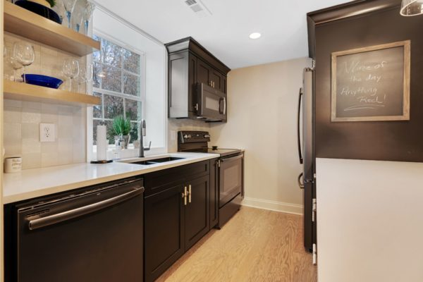 Small basement kitchen complete with floating shelves.