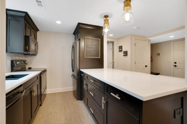 Custom cabinets used to create a small kitchen space in this basement project.