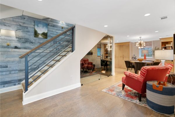 Rustic shiplap, and metal railings create an awesome look in this finished basement.