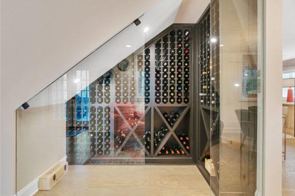 Space under stairway used to create custom wine storage.