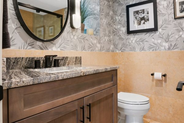 Custom stained vanity cabinet with granite countertop.
