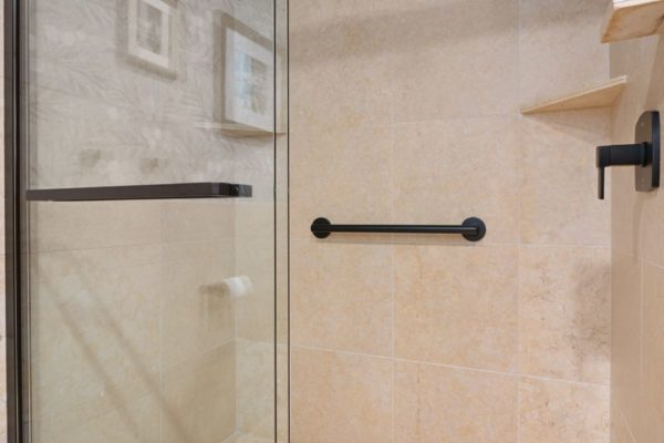 Tile shower with sliding bypass door.