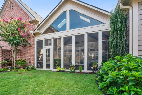 New screened porch addition looks original to the home.
