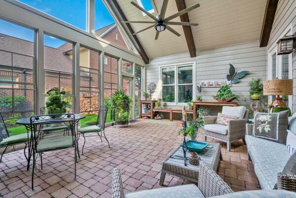 Eze-Breeze windows turn a screened porch into a 3 season room.