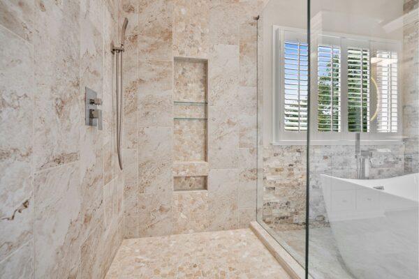 Mosaic accents in this tall shampoo niche.