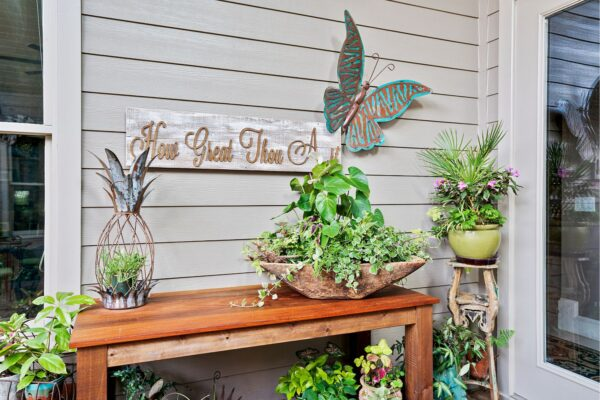 Beautiful plants decorate this new screened porch addition.