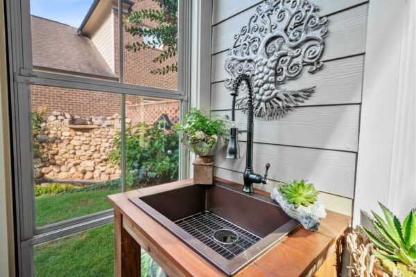 Custom built potting table with sink, and pro-style faucet.
