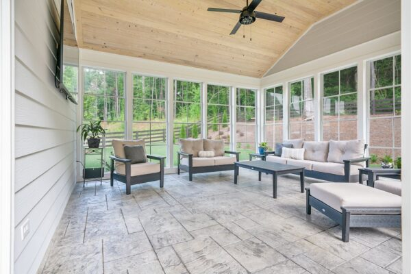 Stamped concrete completes the look of this new 3 seasons room addition.