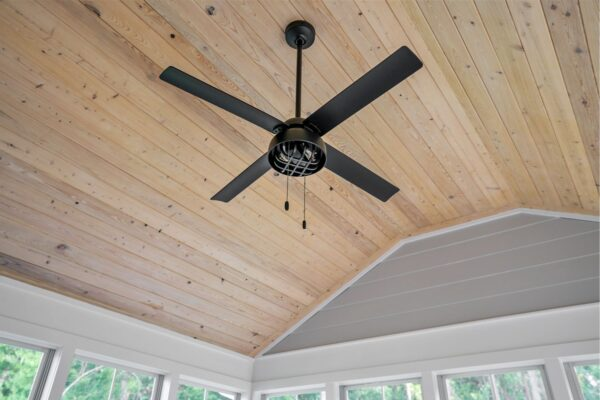Modern style ceiling fan against the backdrop of this natural wood tongue and groove ceiling.