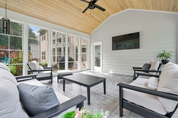 Easy access to outdoor grilling patio from this 3 seasons room addition.