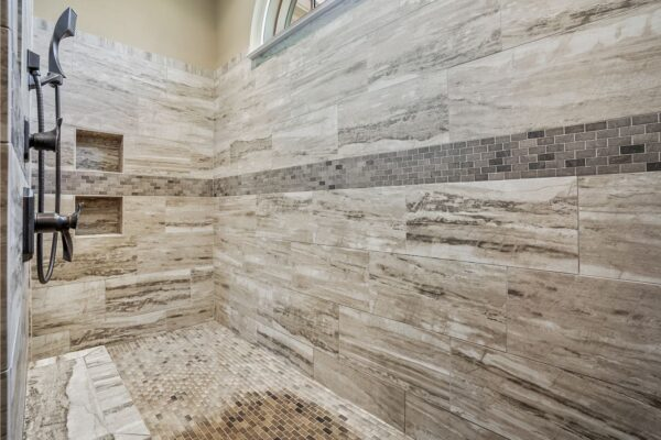 large format tile shower with accent band