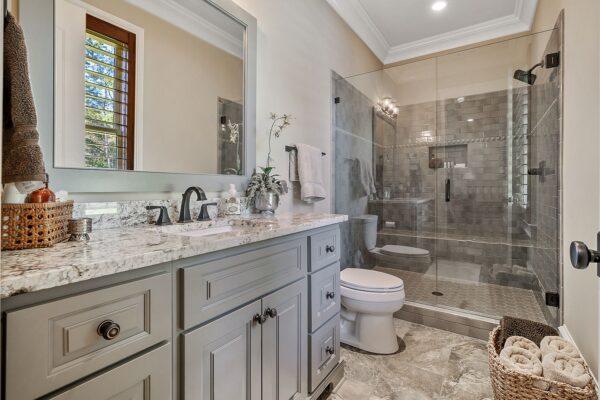 custom painted cabinetry, frameless shower door