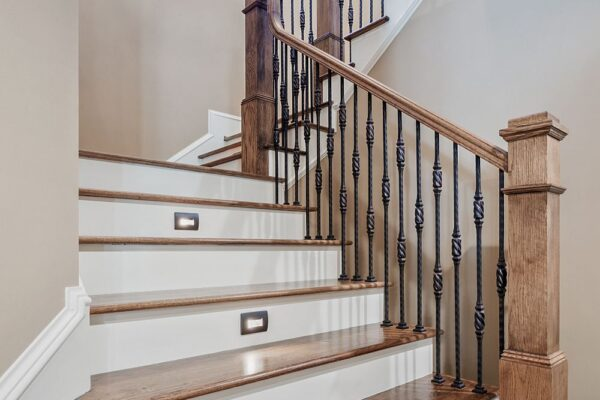 stairway with hardwood treads, and recessed step lights