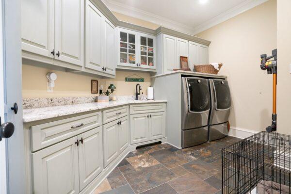 custom laundry cabinets with granite countertops