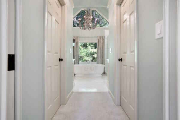 His and her closets as you enter this new master bathroom.