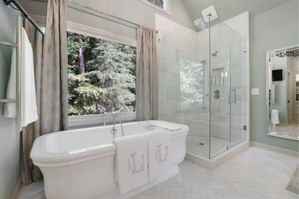 Large freestanding tub with floor mounted faucet.