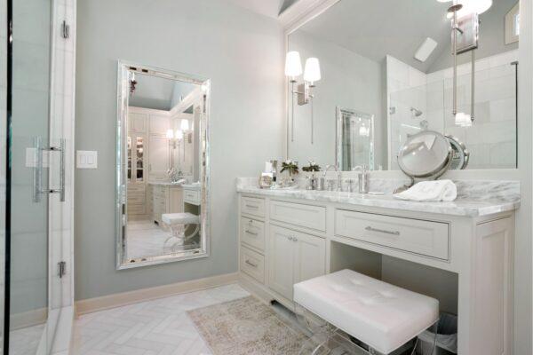 Full length mirror creates a handy dressing area in this master bathroom.