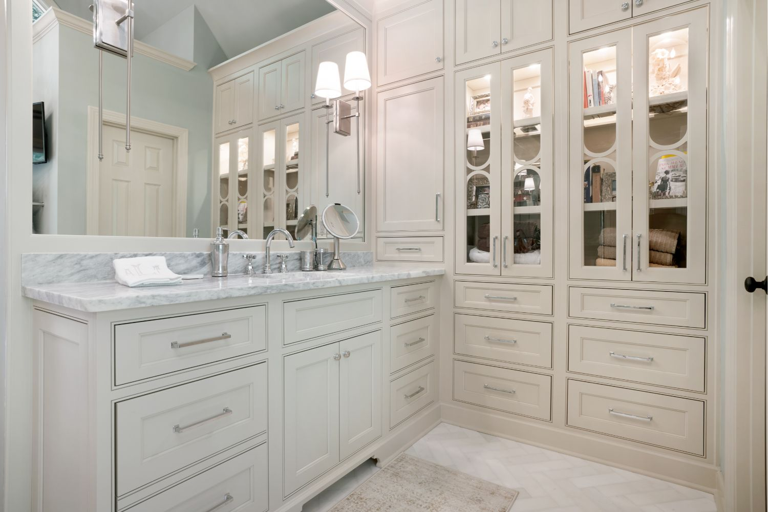Newly renovated master bath with custom full height linen cabinets.