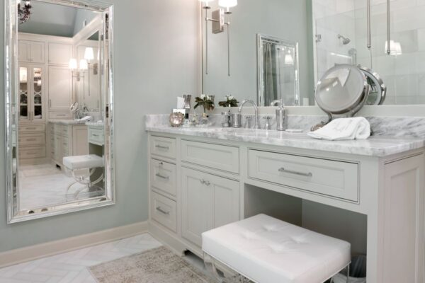 Custom vanity cabinets, with inset doors, and kneespace for makeup area.