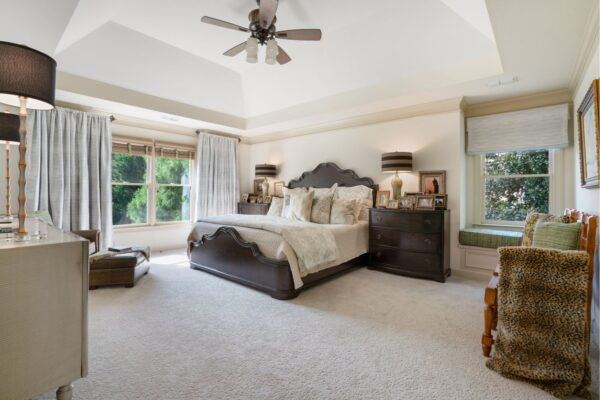 Master bedroom with tray ceiling.