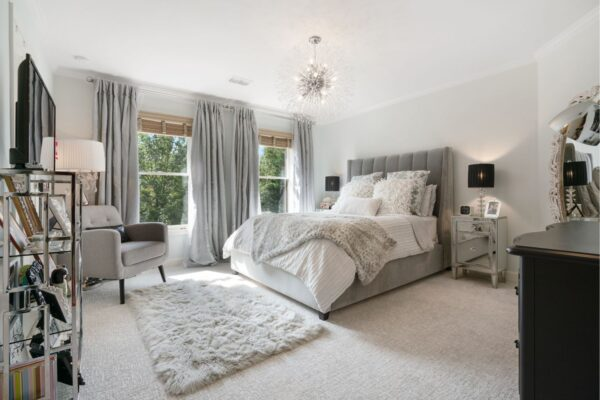 Beautiful bedroom with new patterned carpet.