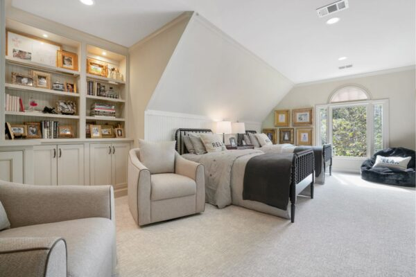 Double twin beds in this newly remodeled bedroom space.