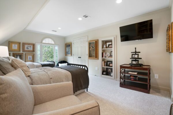 Remodeled bedroom space with recessed cabinetry, and new carpet.