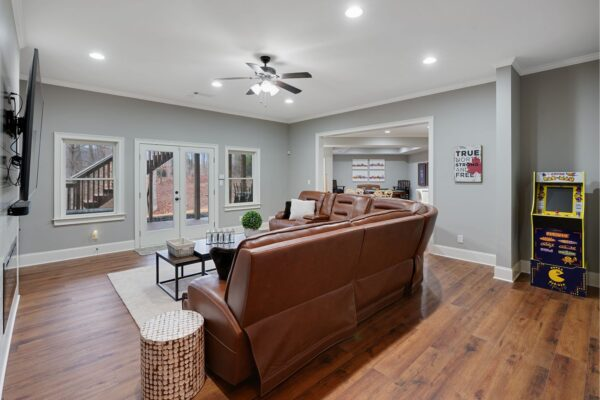 Remodeled basement space with wide plank LVP flooring.