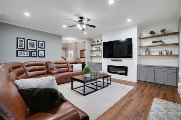Electric fireplace and shiplap accents creates a cozy space in this newly remodeled basement.