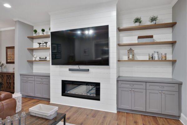 Built in cabinetry, and floating shelves create much needed storage.