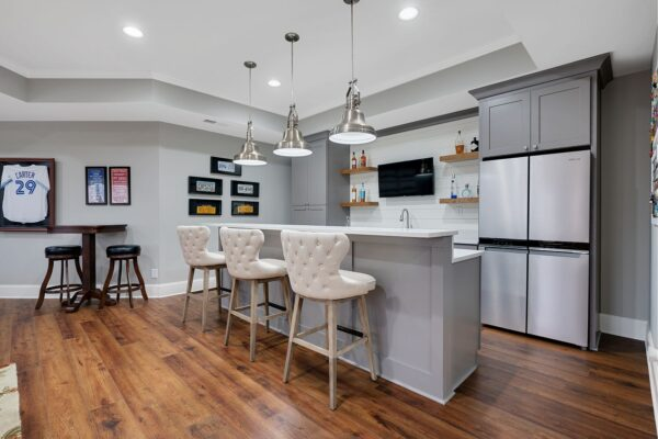 Gray shaker style cabinets create this basement bar space.