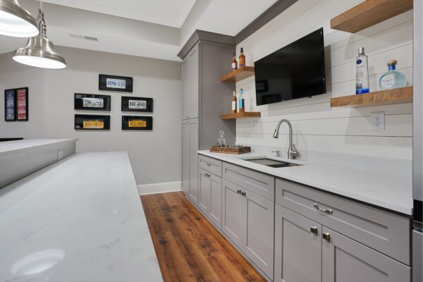 Full overlay, shaker style cabinets, with quartz countertops.
