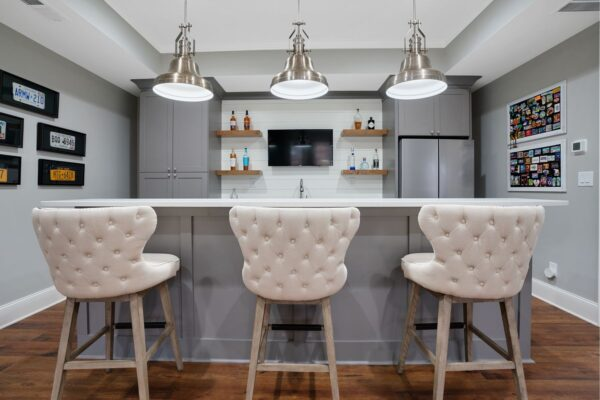 Basement bar with seating for three.